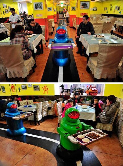 上周六,哈尔滨一家餐馆内,一个机器人端着空盘子。该餐馆使用了20个机器人负责烹饪和上菜。据媒体报道,这些机器人充电两小时后可连续工作五个小时,能够表达10多种面部表情,可以对顾客说基本的问候语